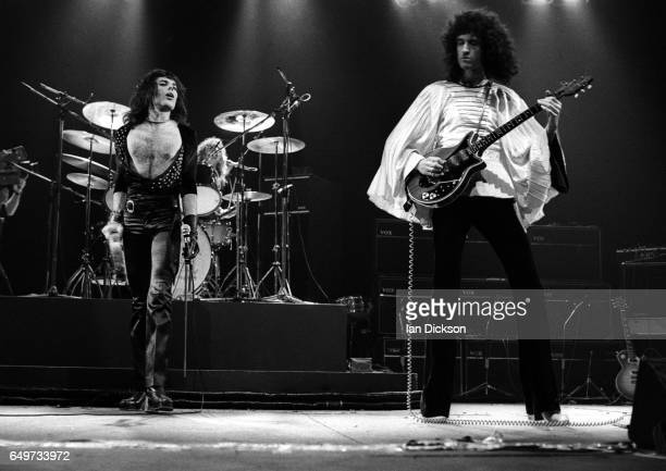 Freddie Mercury Roger Taylor and Brian May of Queen perform on stage on the 'Sheer Heart Attack' tour Rainbow Theatre London 19 November 1974 They...