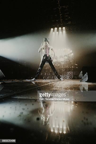 Freddie Mercury singing in black leather pants at Nippon Budokan Tokyo April 14 1979