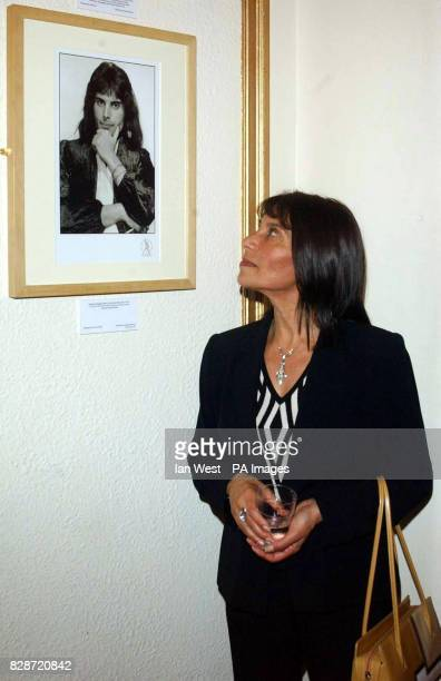 Freddie Mercury's sister Kashmira Cooke looks at a picture of Freddie as she arrives for the 1st anniversary performance of Brian May and Ben Elton's...