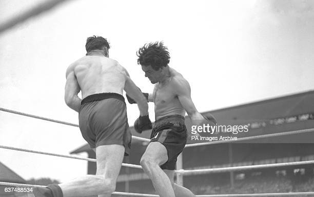 Freddie Mills and Len Harvey in action during the fight