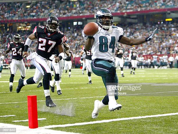 Freddie Mitchell of the Philadelphia Eagles highsteps into the endzone for a touchdown after beating safety Cory Hall of the Atlanta Falcons during...