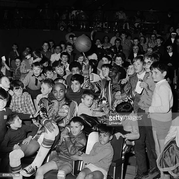 Freddie Neal and Meadowlark Lemon of the Harlem Globetrotters in Paris with young fans