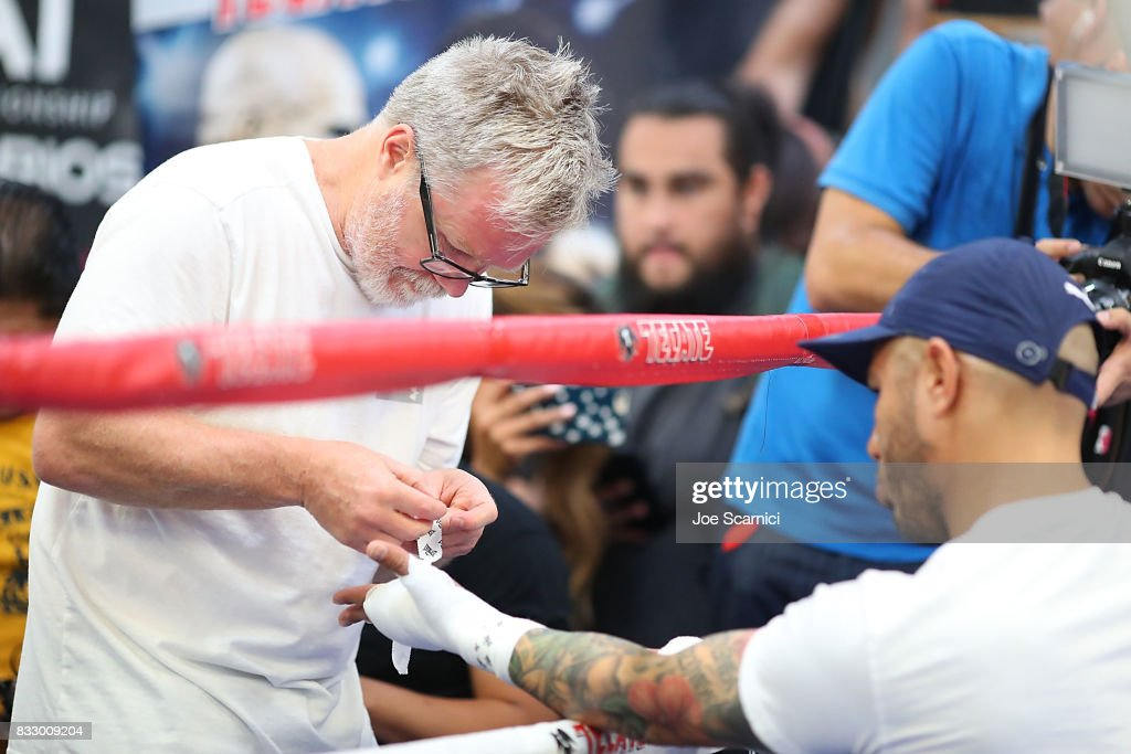 Freddie Roach wraps Miguel Cotto's hands with tape prior to training on August 16, 2017 in Los Angeles, California.