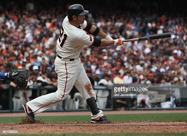 Freddie Sanchez of the San Francisco Giants hits a two run single in the sixth inning against the Los Angeles Dodgers during a Major League Baseball...