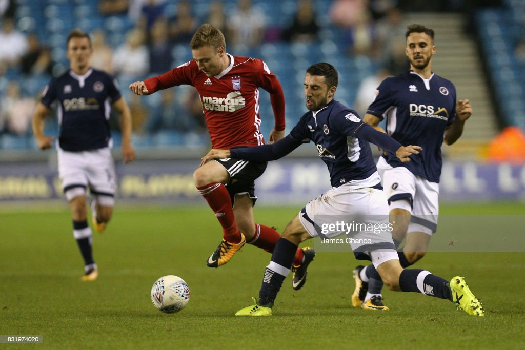 Freddie Sears of Ipswich takes the ball past Connor McLaughlin of Millwall during the Sky Bet Championship match between Millwall and Ipswich Town at The Den on August 15, 2017 in London, England.