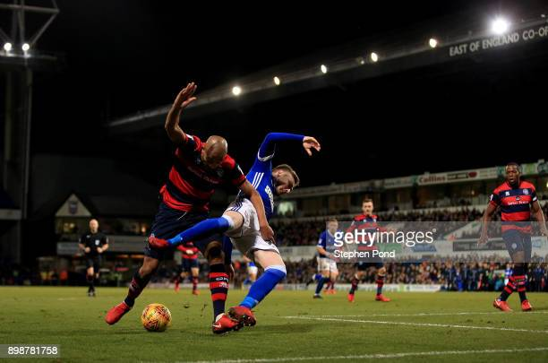 Freddie Sears of Ipswich Town and Alex Baptiste of Queens Park Rangers compete for the ball during the Sky Bet Championship match between Ipswich...