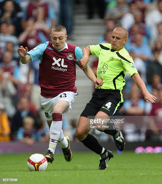 Freddie Sears of West Ham United and Lee Cattermole of Wigan Athletic in action during the Barclays Premier League match between West Ham United and...