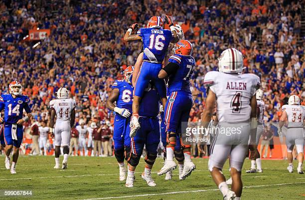 Freddie Swain of the Florida Gators celebrates with teammates after scoring a 2point conversion during the second half of the game against the...