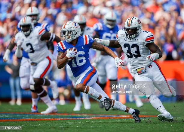 Freddie Swain of the Florida Gators scores a touchdown during the first quarter of a game against the Auburn Tigers at Ben Hill Griffin Stadium on...