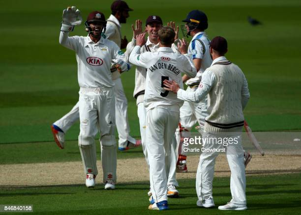 Freddie van den Bergh of Surrey celebrates with team mates after tacking the wicket of Yorkshire's Gary Balance during day three of the Specsavers...
