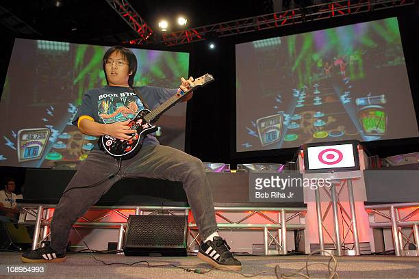 Freddie Wong 22 from SeattleWashington performs during the Guitar Hero II video game contest presented by Target at the E for All Expo on October 20...