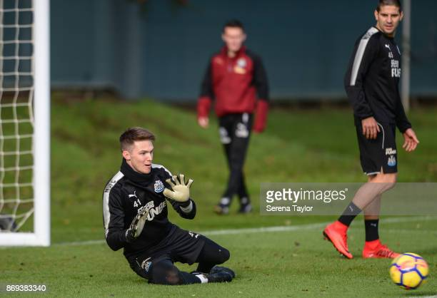 Freddie Woodman dives for the ball during the Newcastle United Training session at The Newcastle United Training Centre on November 2 in Newcastle...