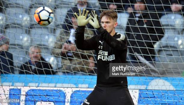 Freddie Woodman of Newcastle United warms up prior to The Emirates FA Cup Third Round match between Newcastle United and Luton Town at St James' Park...