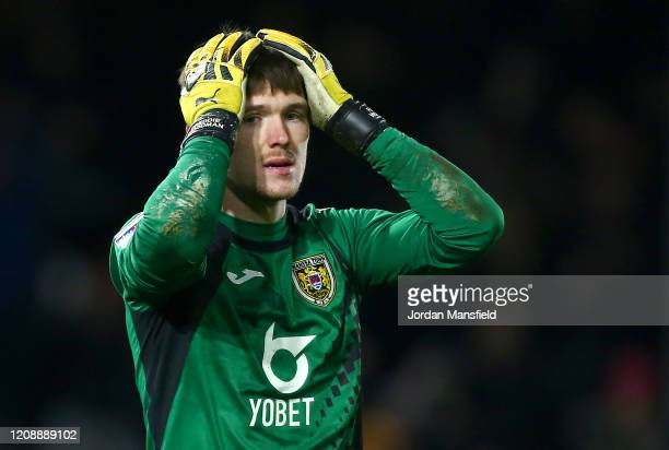 Freddie Woodman of Swansea City reacts to conceding his sides first goal during the Sky Bet Championship match between Fulham and Swansea City at...