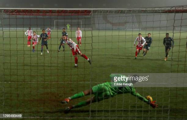 Freddie Woodman of Swansea City saves a penalty from Luke Norris of Stevenage during the FA Cup Third Round match between Stevenage and Swansea City...