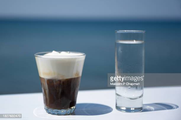 freddo cappuccino - iced coffee drink popular in greece - coffee drink stock pictures, royalty-free photos & images