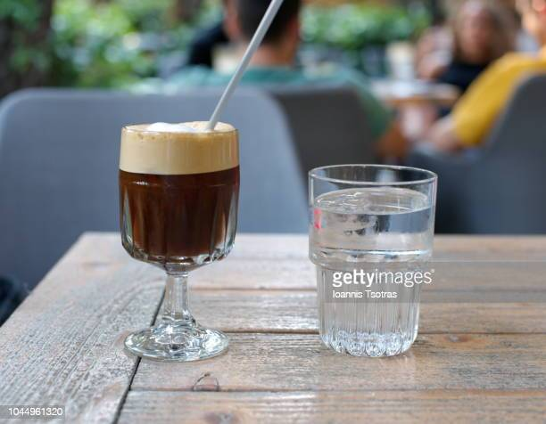 freddo espresso coffee and a glass of cold water - mocha stock pictures, royalty-free photos & images