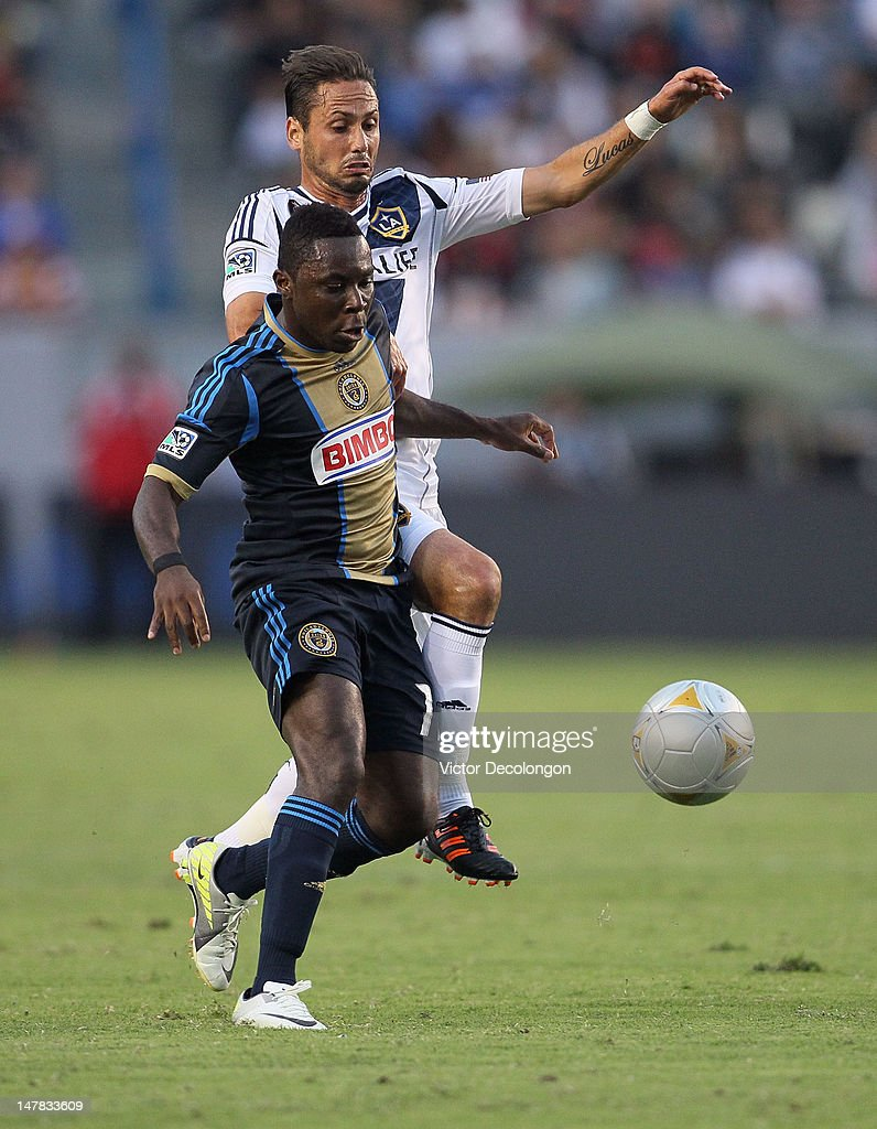 Freddy Adu #11 if the Philadelphia Union vies for position against Marcelo Sarvas #8 of the Los Angeles Galaxy in the first half during the MLS match at The Home Depot Center on July 4, 2012 in Carson, California.