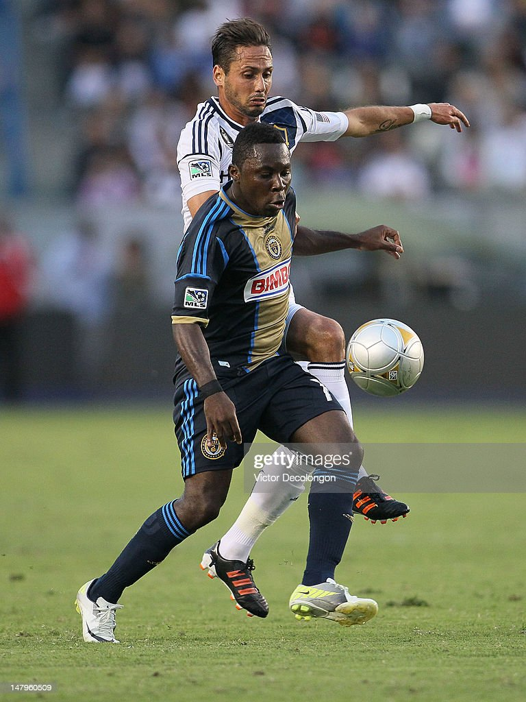 Freddy Adu #11 if the Philadelphia Union vies for position to the ball against Marcelo Sarvas #8 of the Los Angeles Galaxy in the first half during the MLS match at The Home Depot Center on July 4, 2012 in Carson, California. The Union defeated the Galaxy 2-1.