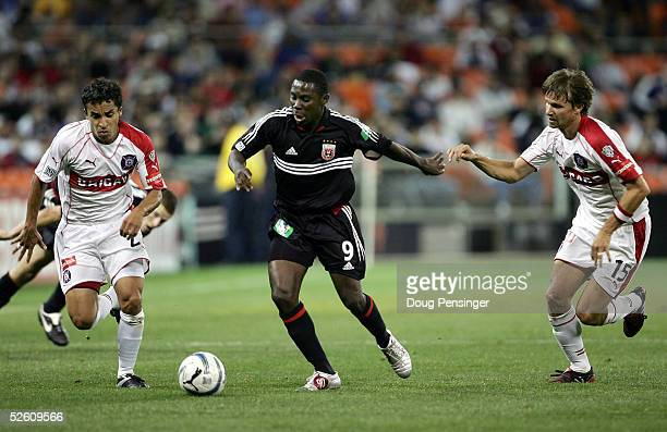 Freddy Adu of DC United looks to control the ball while under pressure from Ivan Guerrero and Jesse Marsch of the Chicago Fire as DC United deteated...