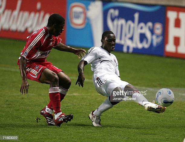 Freddy Adu of DC United passes the ball around Dasan Robinson of the Chicago Fire on July 22 2006 at Toyota Park in Bridgeview Illinois