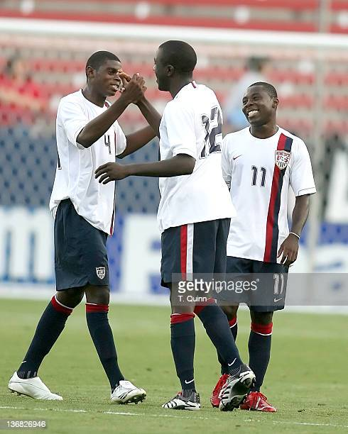 Freddy Adu watches as teammates Anthony Wallace#4 and Josmer Altidore greet each other after the Haiti match. US U20 Men's World Cup team beat...