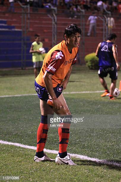 Freddy Bareiro of Cerro Porteno applies mosquito repellent due to the dengue epidemic in Paraguay during the match against Santos as part of the...