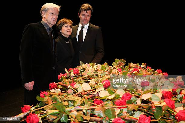 Freddy Burger manager of Udo Juergens Paola Felix and John Juergens son of Udo Juergens pose in front of a piano with roses lieing ontop at a...