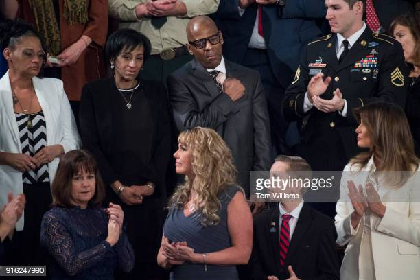 Freddy Cuevas top center and Evelyn Rodriguez in black parents of Kayla Cuevas who was killed by MS13 gang members are recognized by President Donald...