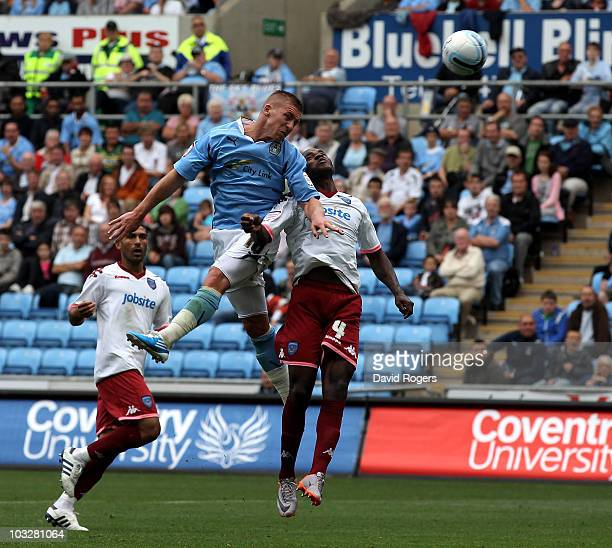 Freddy Eastwood of Coventry City heads his second goal during the npower Championship match between Coventry City and Portsmouth at the Ricoh Arena...
