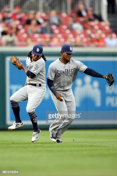Freddy Galvis and Franchy Cordero of the San Diego Padres run into each other allowing Bryce Harper of the Washington Nationals to reach second base...