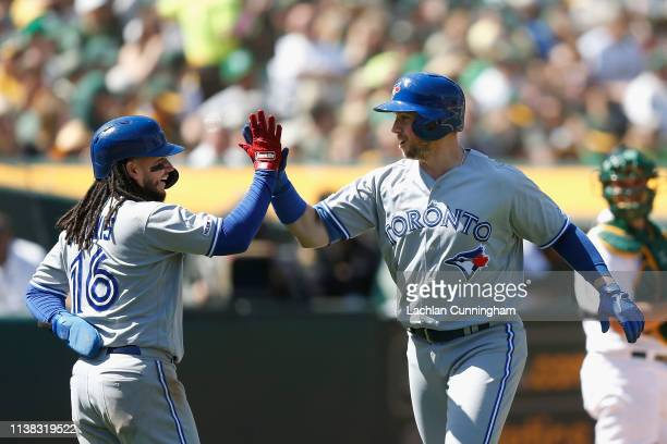 Freddy Galvis and Justin Smoak of the Toronto Blue Jays celebrate after both scoring on a tworun home run hit by Smoak in the top of the sixth inning...