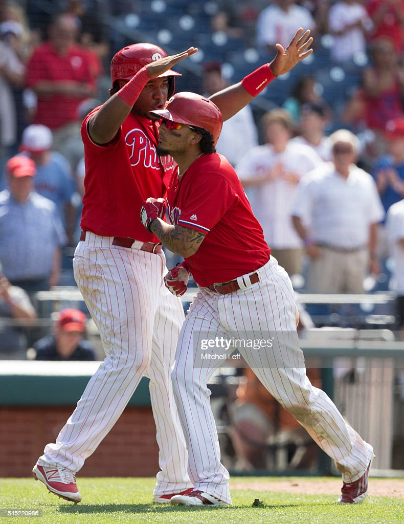 Freddy Galvis #13 and Maikel Franco #7 of the Philadelphia Phillies react after a two run home run hit by Galvis in the bottom of the eighth inning against the Atlanta Braves at Citizens Bank Park on July 6, 2016 in Philadelphia, Pennsylvania. The Phillies defeated the Braves 4-3.