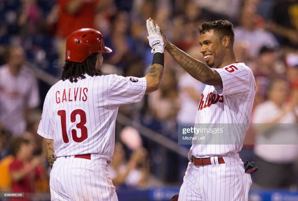 Freddy Galvis #13 and Nick Williams #5 of the Philadelphia Phillies celebrate after scoring on a three run home run hit by Rhys Hoskins #17 of the Philadelphia Phillies (NOT PICTURED) in the bottom of the third inning against the Miami Marlins at Citizens Bank Park on August 23, 2017 in Philadelphia, Pennsylvania.