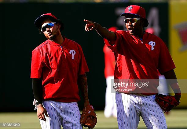 Freddy Galvis left and Maikel Franco of the Philadelphia Phillies in the outfield before the start of an MLB game against the Washington Nationals at...