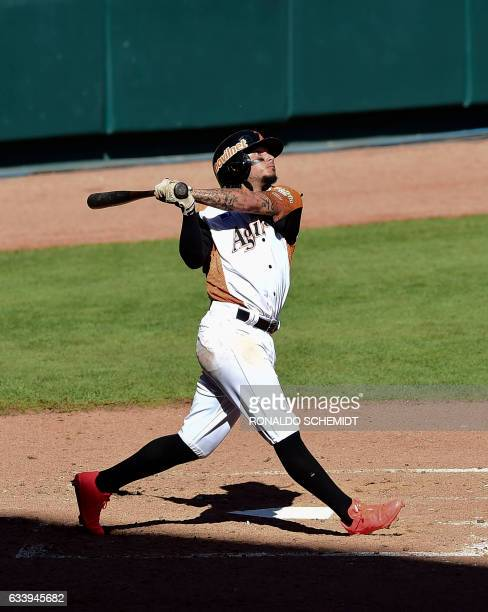 Freddy Galvis of Aguilas del Zulia of Venezuela bats against Tigres del Licey of the Dominican Republic during the Caribbean Baseball Series at the...