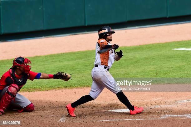 Freddy Galvis of Aguilas del Zulia of Venezuela bats during a Caribbean Baseball Series match against Criollos de Caguas from Puerto Rico at the...