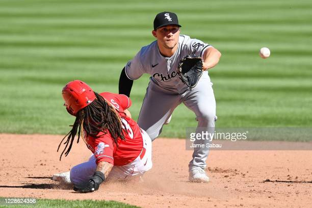 Freddy Galvis of the Cincinnati Reds beats the throw to Yolmer Sánchez of the Chicago White Sox to break up a double play attempt in the fifth inning...