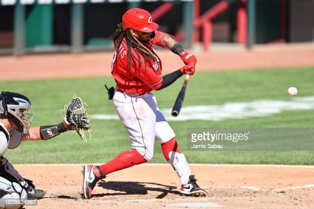 Freddy Galvis of the Cincinnati Reds hits a single in the fifth inning against the Chicago White Sox at Great American Ball Park on September 20,...