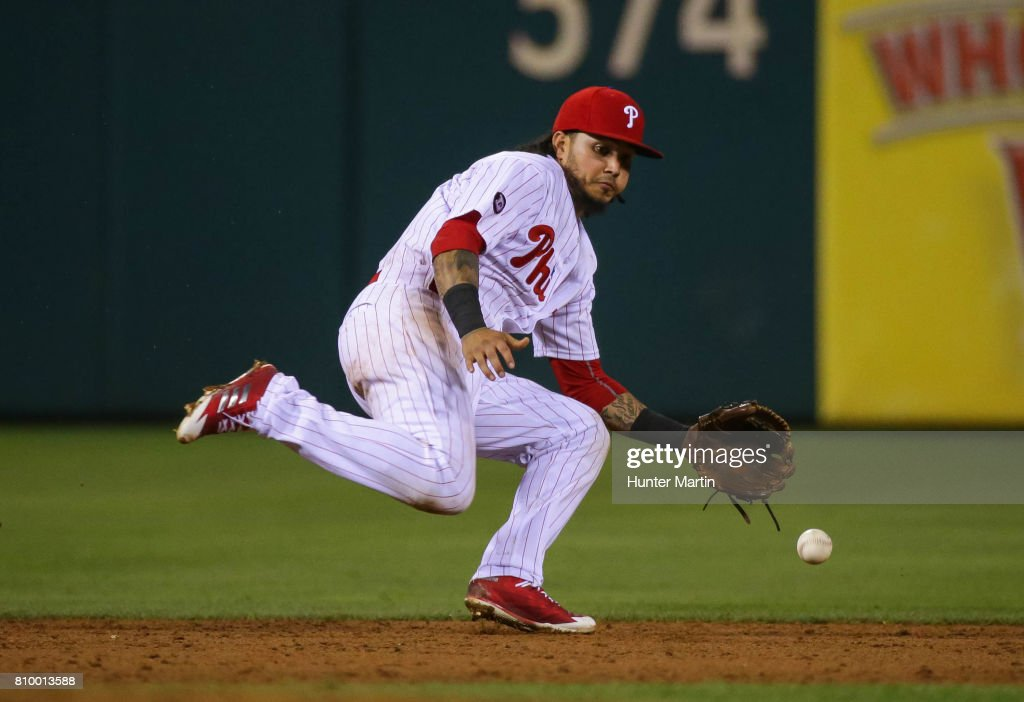 Freddy Galvis #13 of the Philadelphia Phillies attempts to field a ground ball in the ninth inning during a game against the Pittsburgh Pirates at Citizens Bank Park on July 6, 2017 in Philadelphia, Pennsylvania. The Pirates won 6-3.