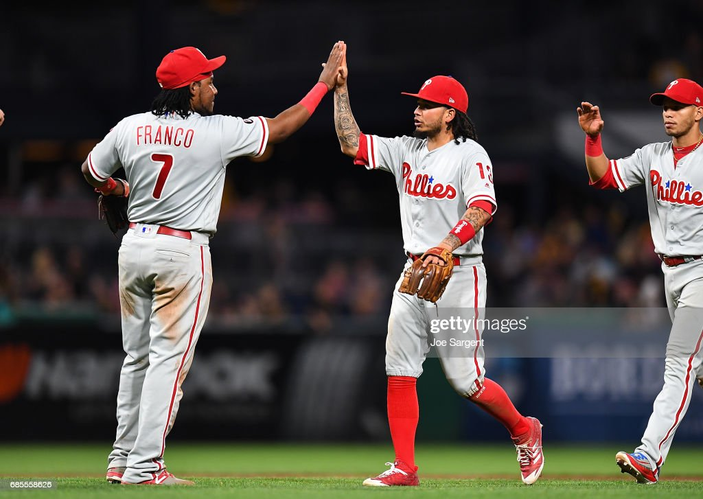 Freddy Galvis #13 of the Philadelphia Phillies celebrates with Maikel Franco #7 after a 7-2 win over the Pittsburgh Pirates at PNC Park on May 19, 2017 in Pittsburgh, Pennsylvania.