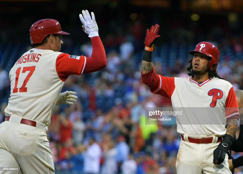 Freddy Galvis #13 of the Philadelphia Phillies congratulates teammate Rhys Hoskins #17 on a two run home run in the first inning against the Chicago Cubs at Citizens Bank Park on August 25, 2017 in Philadelphia, Pennsylvania.