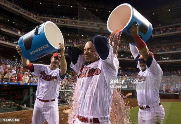 Freddy Galvis of the Philadelphia Phillies gets sports drink poured on him by Tommy Joseph and Andres Blanco after the game against the Pittsburgh...