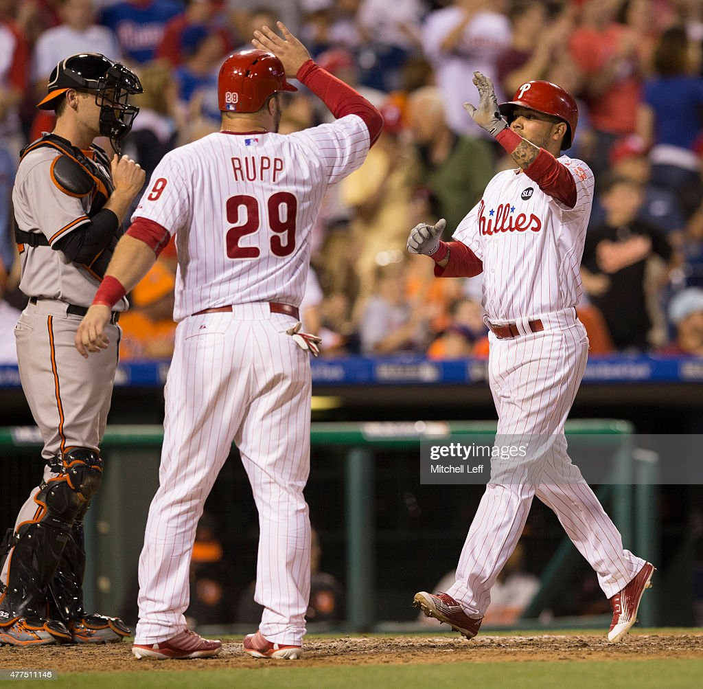 Freddy Galvis #13 of the Philadelphia Phillies high fives Cameron Rupp #29 after hitting a three run home run in the bottom of the seventh inning against the Baltimore Orioles on June 17, 2015 at the Citizens Bank Park in Philadelphia, Pennsylvania. The Orioles defeated the Phillies 6-4.