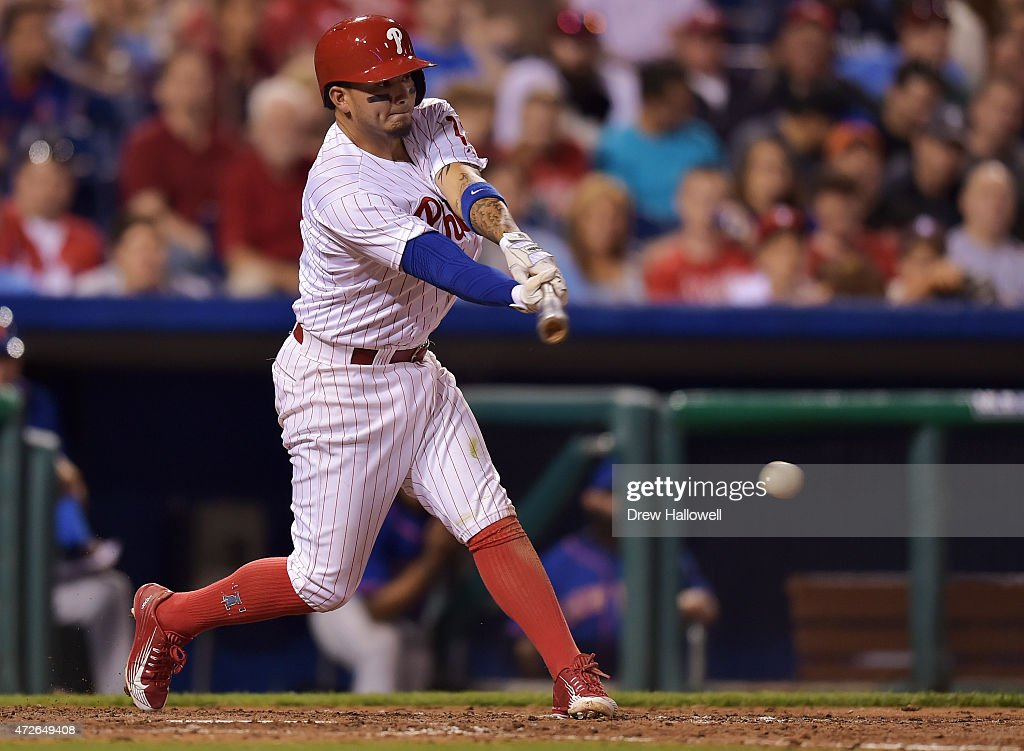 Freddy Galvis #13 of the Philadelphia Phillies hits a single in the eighth inning against the New York Mets at Citizens Bank Park on May 8, 2015 in Philadelphia, Pennsylvania. The Phillies won 3-1.