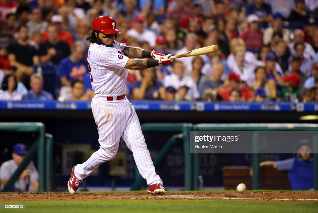 Freddy Galvis #13 of the Philadelphia Phillies hits an RBI single in the fifth inning during a game against the New York Mets at Citizens Bank Park on August 12, 2017 in Philadelphia, Pennsylvania. The Phillies won 3-1.