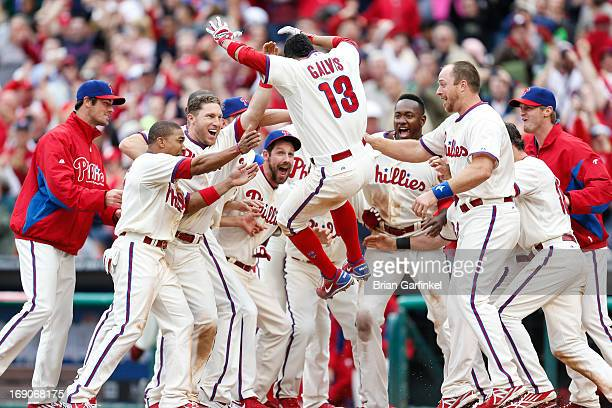 Freddy Galvis of the Philadelphia Phillies leaps home after hitting a home run in the bottom of the ninth inning to win the game against the...