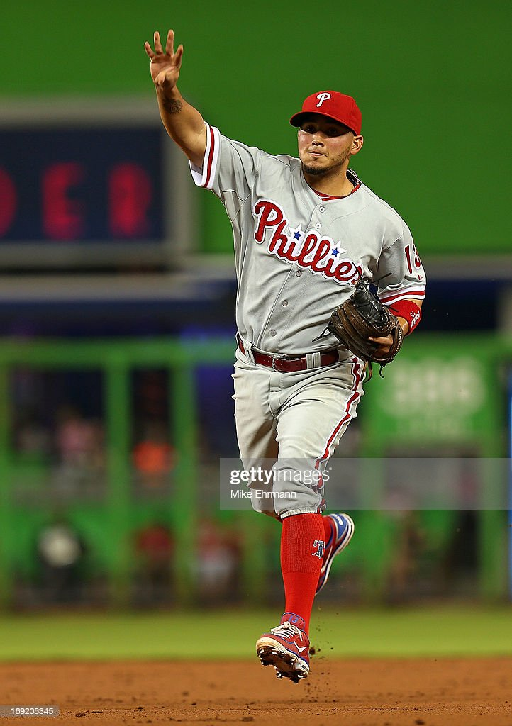 Freddy Galvis #13 of the Philadelphia Phillies looks on during a game against the Miami Marlins at Marlins Park on May 21, 2013 in Miami, Florida.