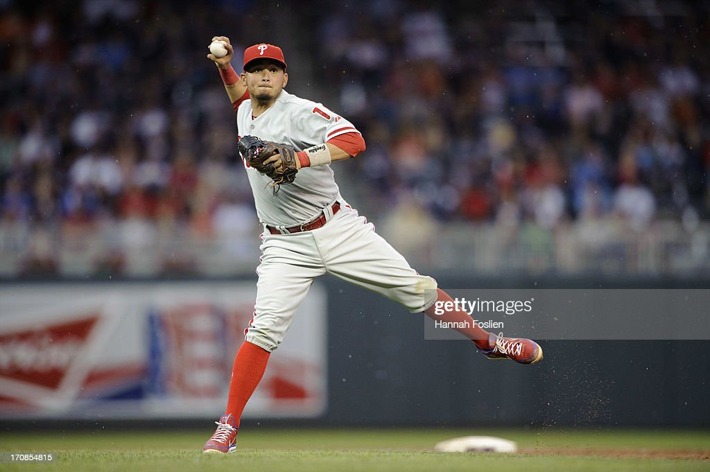 Freddy Galvis #13 of the Philadelphia Phillies makes a play at second base during the game against the Minnesota Twins on June 12, 2013 at Target Field in Minneapolis, Minnesota.