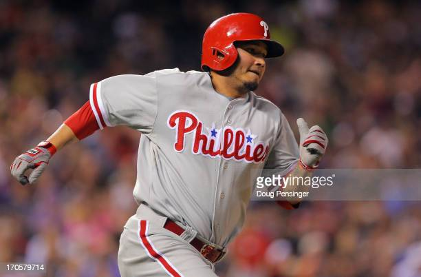 Freddy Galvis of the Philadelphia Phillies rounds the bases on a two RBI triple off of Wilton Lopez of the Colorado Rockies to tie the score 77 in...
